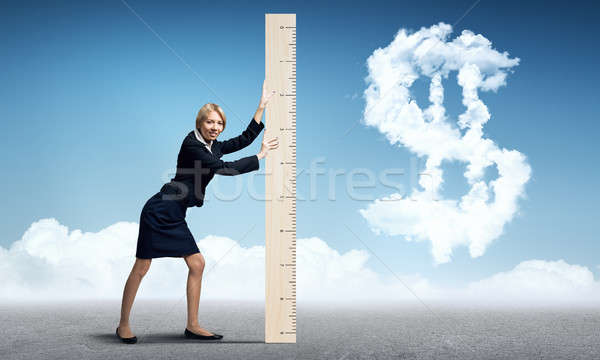 Kadın cetvel genç işkadını dolar işareti Stok fotoğraf © adam121