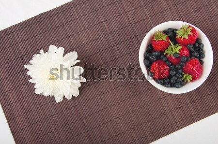 strawberries, bilberry and flower on bamboo tablecloth Stock photo © adam121