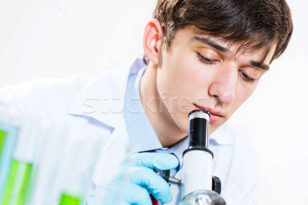 milled scientist looking into a microscope Stock photo © adam121