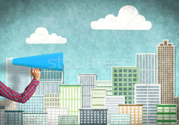 Hand of woman holding blue paper trumpet against illustrated background Stock photo © adam121