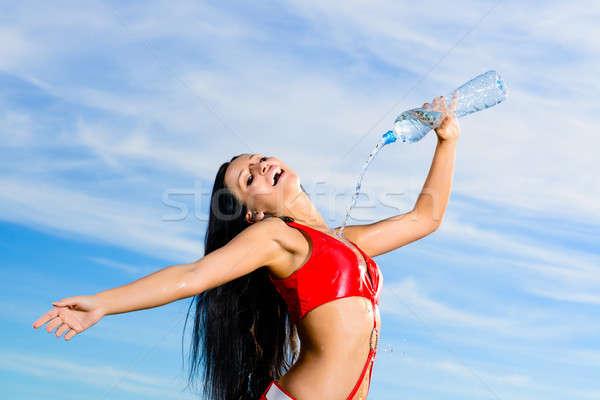 Esportes menina vermelho uniforme garrafa água Foto stock © adam121