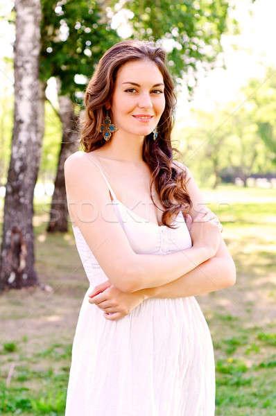Portré vonzó nő park égbolt tavasz fű Stock fotó © adam121