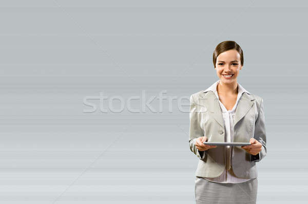 Business woman holding a touchpad Stock photo © adam121
