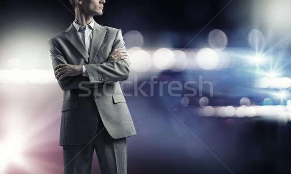 Confident businessman in bokeh lights Stock photo © adam121