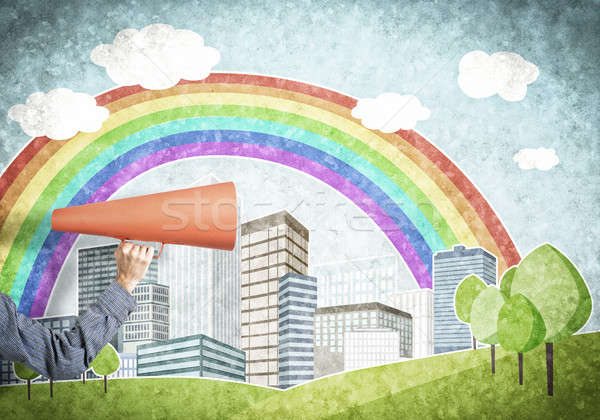 Hand of man holding orange paper trumpet against illustrated background Stock photo © adam121
