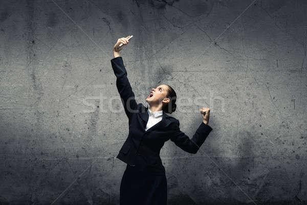 Agresivo gestión jóvenes mujer de negocios gritando teléfono móvil Foto stock © adam121