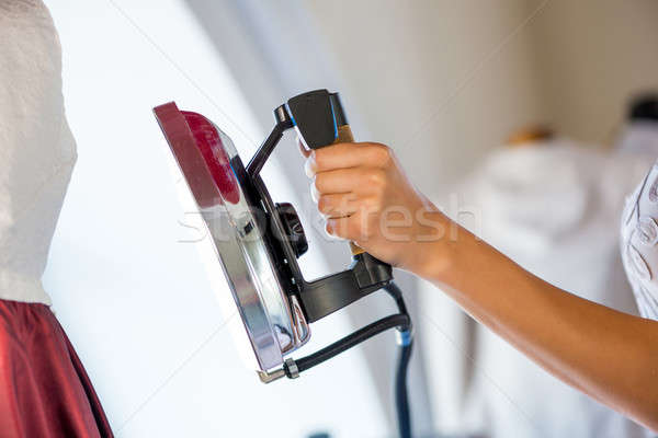 Woman holding iron Stock photo © adam121