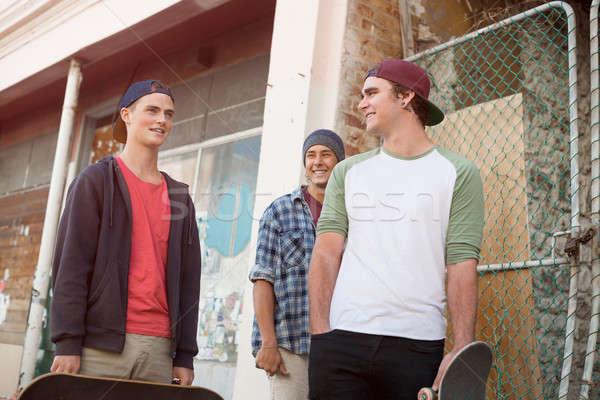 Guys skateboarders in street Stock photo © adam121
