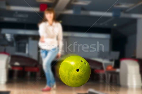 pleasant young woman throws a bowling ball Stock photo © adam121