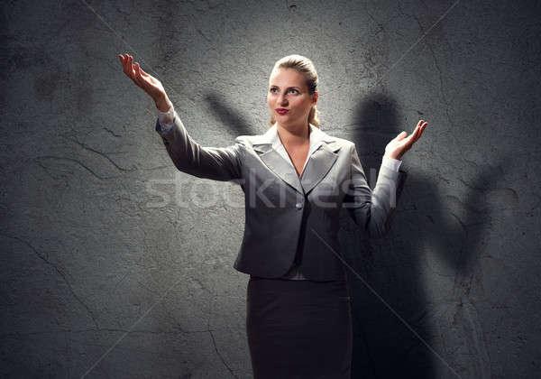 Praying businesswoman Stock photo © adam121