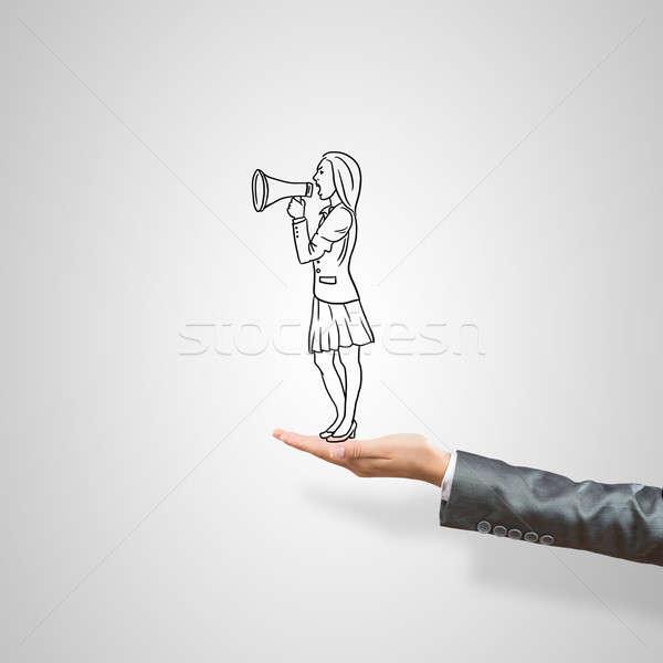 Caricatures of businesswoman in palm Stock photo © adam121