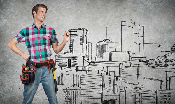 Guy engineer sketching his ideas Stock photo © adam121