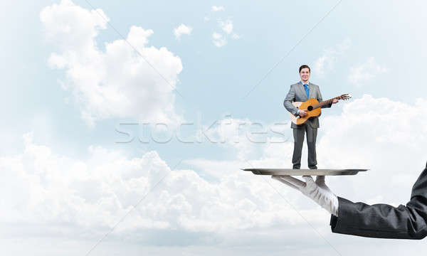 Işadamı Metal tepsi oynama akustik gitar mavi gökyüzü Stok fotoğraf © adam121