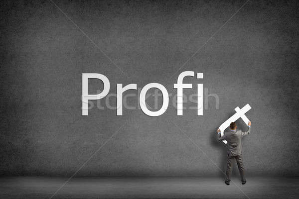 Businessman collects on the wall the word profit Stock photo © adam121