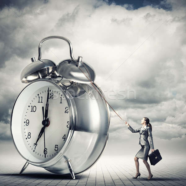 Woman controlling time Stock photo © adam121