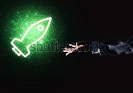 Man palm presenting Rocket web icon as technology concept Stock photo © adam121