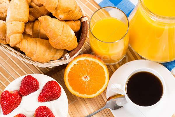 Континентальный завтрак кофе клубника кремом круассан сока Сток-фото © adam121