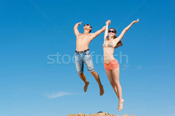 Stock photo: young couple jumping together
