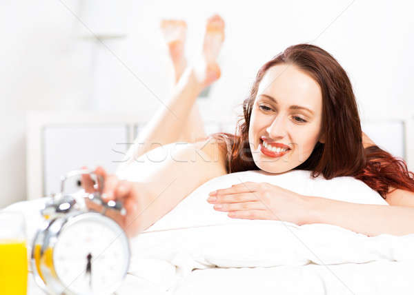 woman turns off the alarm Stock photo © adam121