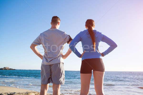 Sabah çalıştırmak genç aktif çift koşucuların Stok fotoğraf © adam121