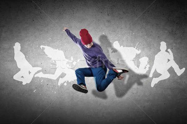 Hip hop danser jonge springen silhouetten grijs Stockfoto © adam121