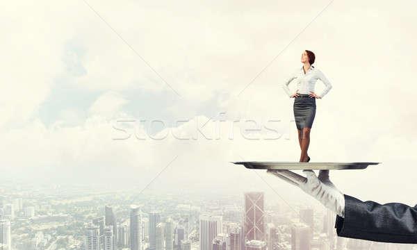 Stock photo: Confident elegant businesswoman presented on metal tray against