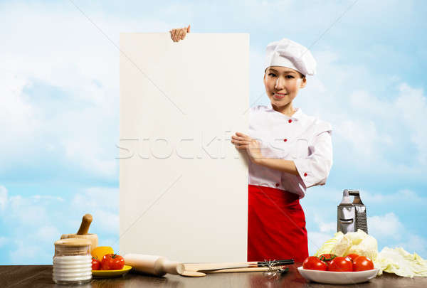 female chef holding a poster for text Stock photo © adam121