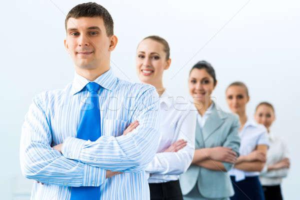 Grup iş adamları ayakta gülen kadın Stok fotoğraf © adam121