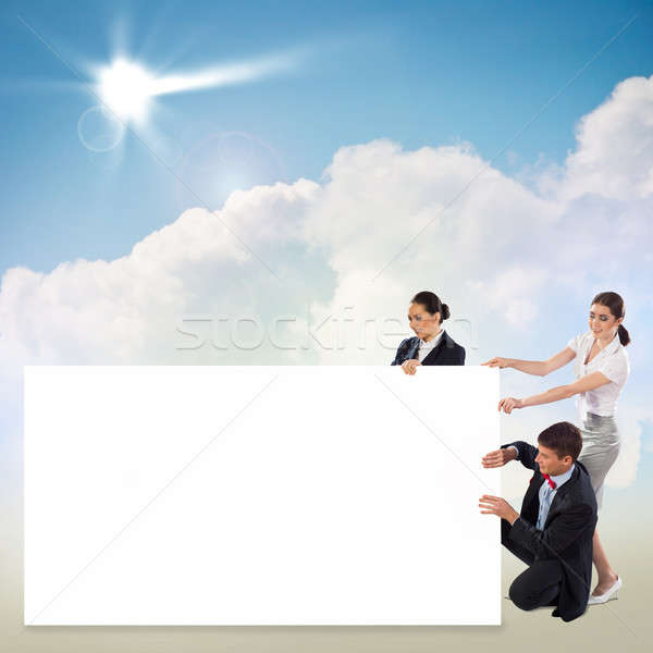 small group of people holding a blank banner Stock photo © adam121