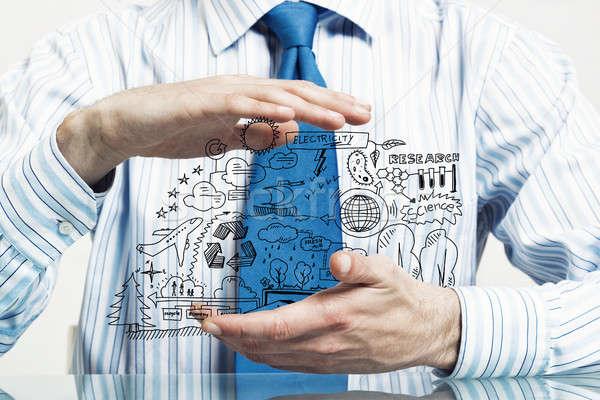 Businessman demonstrate his business plan Stock photo © adam121