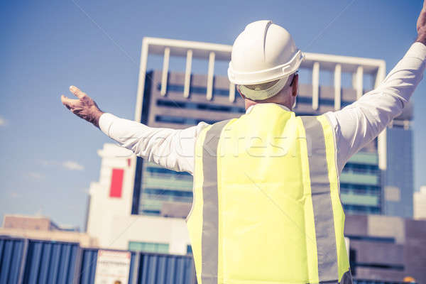 Senior foreman in glasses doing his job at building area on sunn Stock photo © adam121