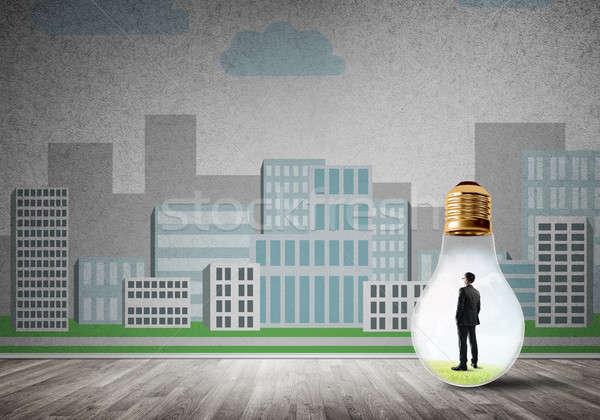 ビジネスマン 閉じ込められた 電球 電球 市 ストックフォト © adam121