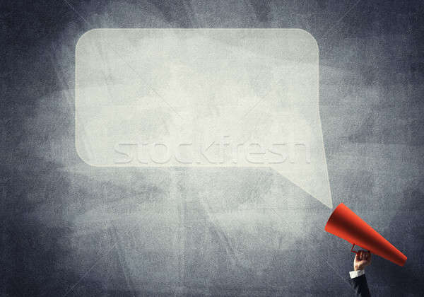 Hand of businesswoman holding red paper trumpet and speech cloud Stock photo © adam121