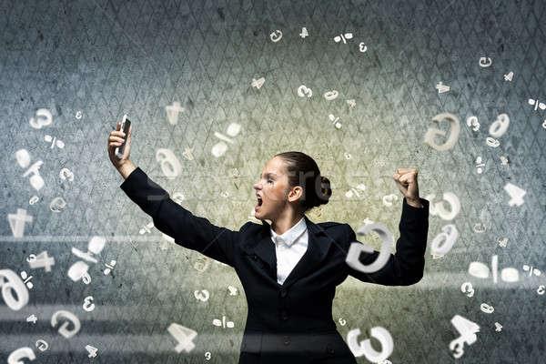 Aggressivo gestione giovani imprenditrice urlando cellulare Foto d'archivio © adam121