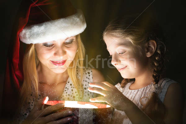 Stock photo: mother and daughter opened a box with a gift