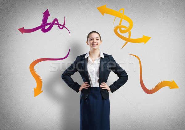 Businesswoman thinking something over Stock photo © adam121