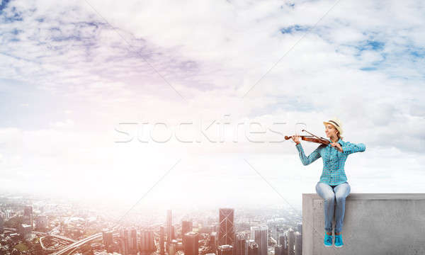 Girl playing violin Stock photo © adam121