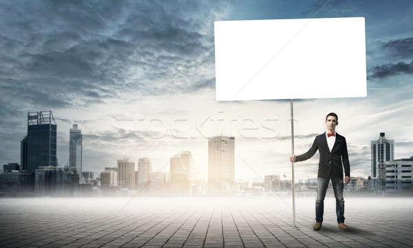 Guy with white billboard Stock photo © adam121