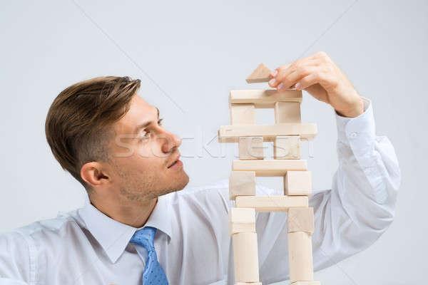 Businessman making tower Stock photo © adam121