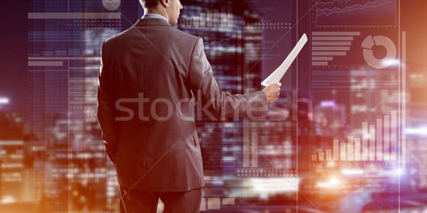 Digital background with infographs and man extending papers or contract Stock photo © adam121