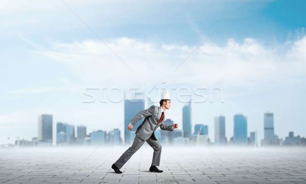 King businessman in elegant suit running and business center at background Stock photo © adam121