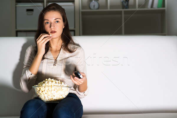 young woman watching TV Stock photo © adam121