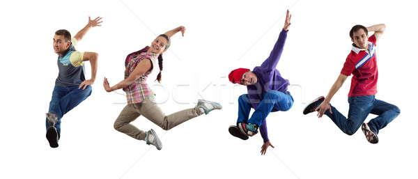 Hip hop dansers groep danser springen geïsoleerd Stockfoto © adam121