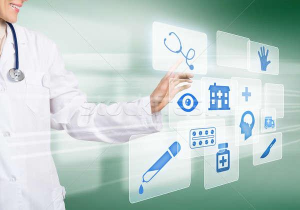 Technologie hulp jonge vrouw arts aanraken icon Stockfoto © adam121