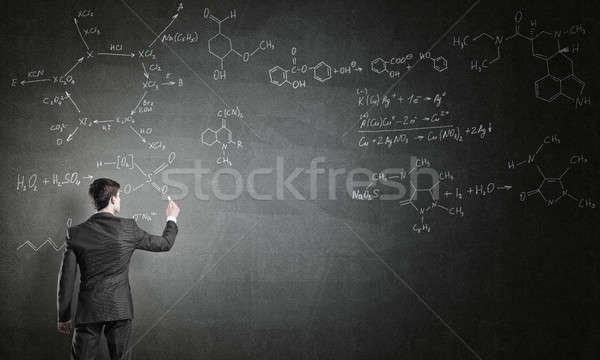 Tudós ír képletek tábla fiatalember öltöny Stock fotó © adam121