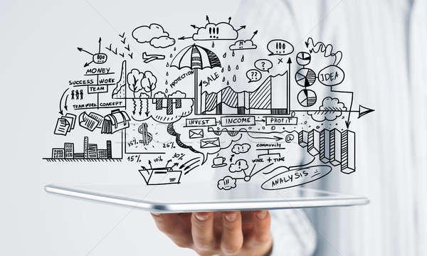 Plano eletrônico negócio empresário mão estratégia de negócios Foto stock © adam121