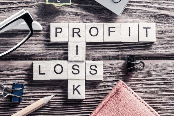 Profit loss and risk words on workplace collected of wooden cube Stock photo © adam121