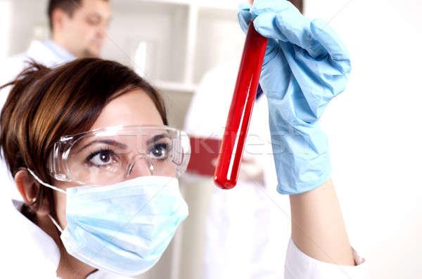 Portret piękna kobieta chemik probówki czerwony Zdjęcia stock © adam121