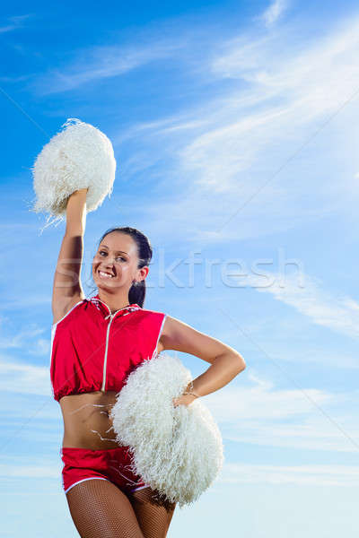 girl cheerleader with pom-poms on the background of blue sky Stock photo © adam121