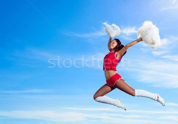 Photo stock: Jeunes · cheerleader · rouge · costume · sautant · ciel · bleu